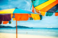 Two colorful sunshades in the beach on a sunny summer day. Summer background with colorful beach umbrellas stock photo