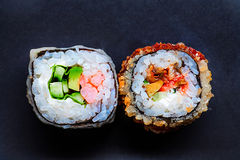 Two colorful sushi on black with copyspace Stock Photos