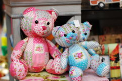Two colorful teddy bears in the shop Stock Image