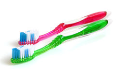 Two colorful tooth-brushes Royalty Free Stock Photography
