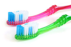 Two colorful tooth-brushes Royalty Free Stock Photos