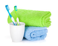 Two colorful toothbrushes and towels Royalty Free Stock Photography