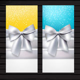 Two colorful vertical flyers with silver bows Stock Photos
