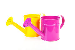 Two colorful watering cans Royalty Free Stock Photos