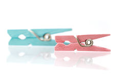 Two colorful wooden clothespins Royalty Free Stock Photography
