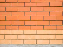 Two colors brick wall Stock Photos