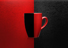 Two colors mug. On red and black background Royalty Free Stock Photos