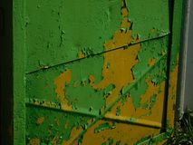 Two colors of old paint. On the iron fence urbanism sun royalty free stock photography