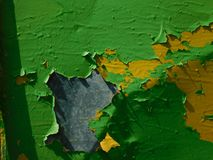 Two colors of old paint. On the iron fence urbanism sun stock photo