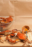 Two colossal steamed and seasoned chesapeake blue claw crabs on a wood cutting board Royalty Free Stock Photos