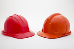 Two coloured helmets Royalty Free Stock Photography