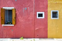 Two coloured houses in Buranos Island royalty free stock photo