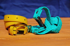 Two coloured leather belts. Closeup view of two coloured leather belts stock photo