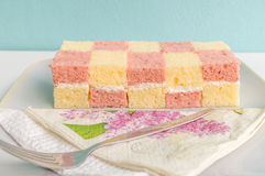Two coloured sponge cake. Two sweet  coloured sponge cake Royalty Free Stock Image