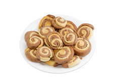 Two coloured sweet roll on white dish Royalty Free Stock Image