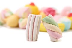 Two colourful marshmallow on background of other. Royalty Free Stock Photography