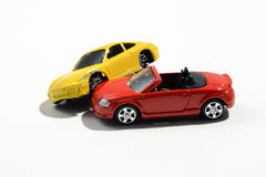 Two colourful metal toy model cars Royalty Free Stock Photos