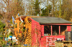 Two colourful sheds. Coloured sheds at an allotment Stock Photos