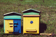Two colourful wooden beehives Stock Photo