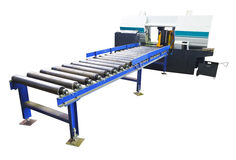 Two-column band saw machine with feeder isolated Stock Images
