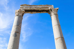 Two columns and portico fragment on blue sky background Royalty Free Stock Photos
