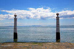 Two columns at the riverside of Lisbon Stock Photography