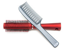 Two combs, red and sulfuric Royalty Free Stock Photo