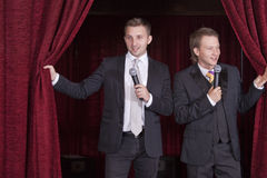 Two comedian actors on stage Stock Image