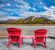 Two comfortable red deck chairs Stock Images
