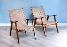 Two comfortable wooden easy chairs stock photo