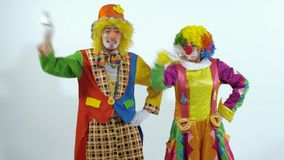 Two comic circus clowns dancing synchronously stock video footage