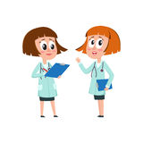 Two comic woman doctor characters filling in medical cards Stock Photos