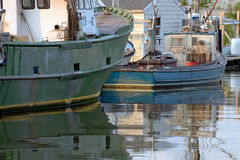 Two commercial fishing ocean going trawlers docked at dusk on ca Royalty Free Stock Image
