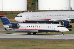 Two Commercial Jets Await Clearance to Take Off Royalty Free Stock Photography