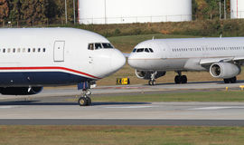 Two Commercial Jets Await Clearance to Take Off Royalty Free Stock Image