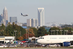 Two Commercial Jets with City Skyline Royalty Free Stock Images