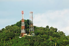 Two communication towers on a hill Royalty Free Stock Image
