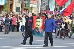 Two Communist have a portrait of Stalin Stock Photos