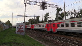 Two commuter trains pass in opposite directions at high speed stock video footage