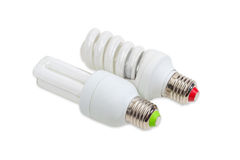 Two compact fluorescent lamp on a light background Royalty Free Stock Photos
