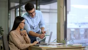 Two company employees preparing report, comparing graphics, business career royalty free stock photos