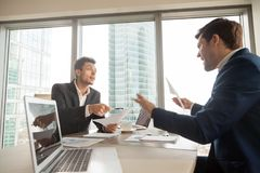 Angry businessman arguing with partner on meeting. Two company leaders intensely discussing or arguing because of contract terms, can not come to agreement royalty free stock photography