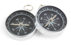 Two compasses with black panel isolated. Two silver compasses with black panel isolated on white, one lying on other royalty free illustration