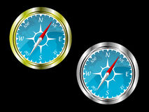 Two compasses in gold and silver Royalty Free Stock Image