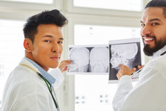 Two competent radiologists. Two doctors as competent radiologists discuss x-ray image diagnose Royalty Free Stock Images
