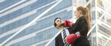 Two competitive businessperson and boxing gloves attacking. One another. concept fight for business. panoramic banner with copy space Stock Photos