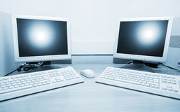 Two computers. On the table stock image