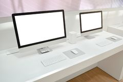 Two computers with isolated screens for mockup on office desk.  royalty free stock photos