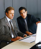 Two concentrated businessmen Royalty Free Stock Images