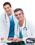Two concentrated male doctors Royalty Free Stock Photos
